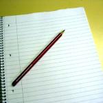 Block mit rotem Bleistift