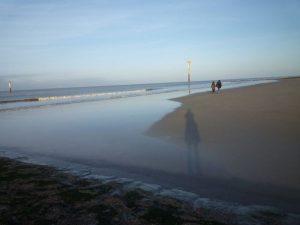 Strand mit Schatten der Fotografin