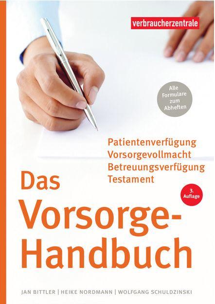 Vorsorge-Handbuch, Cover der Broschüre, eine Hand beim Schreiben