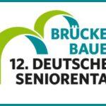 Logo mit zwei stilisierten Brücken